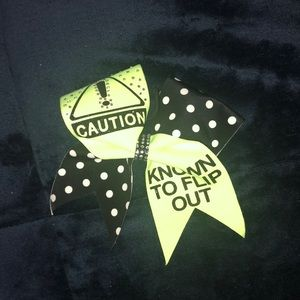 "Neon ""Caution, Known To Flip Out"" Bow"